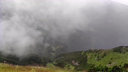 Cloud movement in rain Mountain ranges in cloudy weather near lake nature Stockvideo