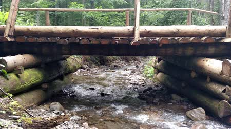 irrigação : Wooden structure artificial waterfall under the man-made bridge Channel concept nature Vídeos