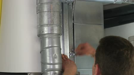 from air : Man changing an old dirty air filter for a brand new clean one in a home furnace. Stock Footage