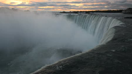 Онтарио : Dark view of Niagara Falls water in opposite to pink clouds of very early sunrise