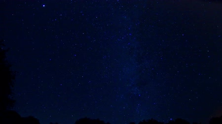 lapso de tempo : Time lapse of stars moving across sky, day-spring. Vídeos