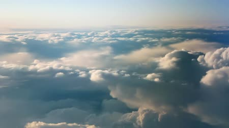 sztratoszféra : Aerial view of clouds over landscape from airplane.