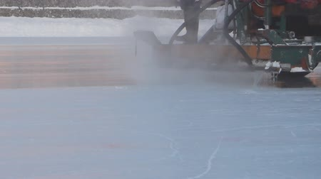 ice skating : the machine floods the ice rink in the winter
