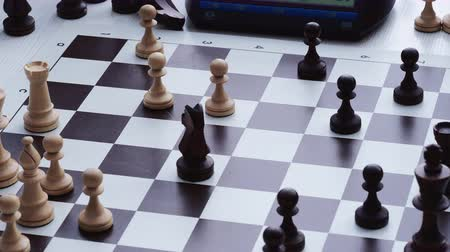 шах и мат : playing chess at the table closeup