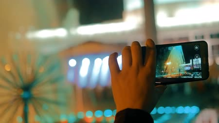 recording on the smartphone of the city fountain at night.