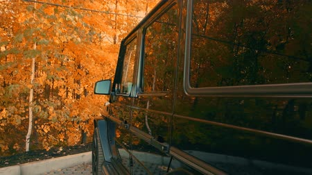 the car in the Parking lot of the forest in autumn.