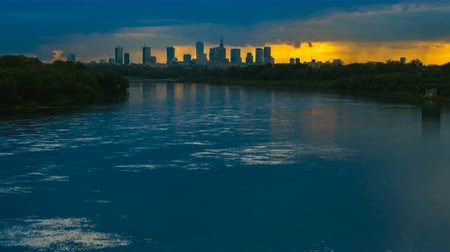 wisla : Timelapse with view on Cityscape of Warsaw City and Buildings and Wisla River with Dramatic Clouds after Sunset