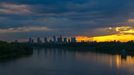 wisla : Timelapse with view on Cityscape of Warsaw City and Buildings and Wisla River with Dramatic Clouds and Sunbeams Stock Footage