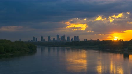 wisla : Timelapse with view on Cityscape of Warsaw City and Buildings and Wisla River at Sunset