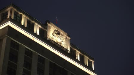 urss : Historical building, symbolism of the USSR, above it, the flag of modern Russia Stock Footage