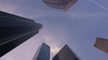bank tower : Low angle shot of camera rotating in front of modern, skyscrapers made of glass