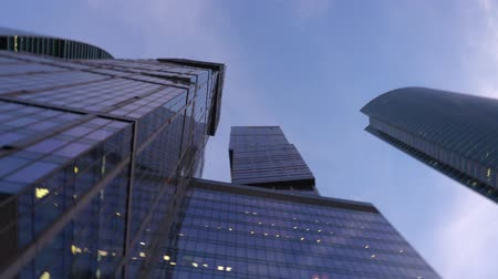 bank tower : Modern, dark blue skyscrapers made of glass. View from below with rotation