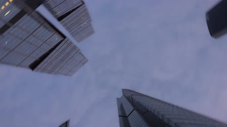 bank tower : Modern skyscrapers, made of glass. Bottom up view with rapid rotation. No people Stock Footage