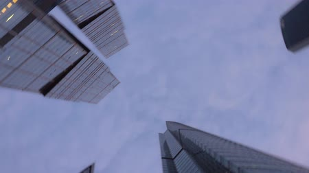 moscow panorama : Panning view from below of the office tower buildings with rapid rotation Stock Footage