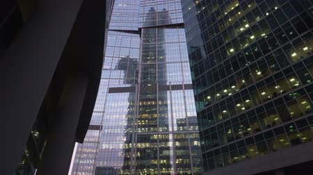 уменьшающийся : Modern, skyscrapers made of glass. Vertical panoramic view from below. Daytime
