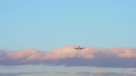 aeroespaço : Two planes are flying in the sky. In background blue sky, purple orange clouds