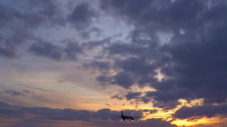 liftoff : Passenger plane flies overhead. Sunset in the background. UltraHD stock footage