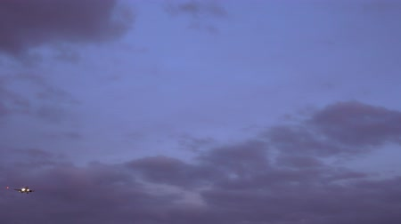 liftoff : Passenger plane flies in the sky. Preparing for landing. purple sky background Stock Footage