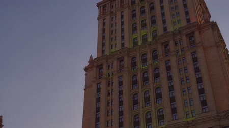 dull : Stalin skyscraper in Moscow. View from the side and bottom of the building. 4K Stock Footage