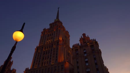 urss : Beautiful Art Deco building. Gets dark, orange facade is highlighted. Purple sky