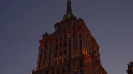 stalin : Beautiful Art Deco style old building. Orange facade is highlighted. Star on top