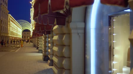 markiza : Facade of a building is decorated with illuminations. Canopies over shop windows