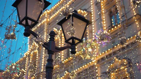 Street lamp, Christmas decorations, garlands, a large number of glowing lights
