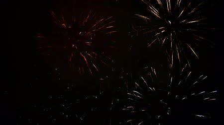 Beautiful, magnificent, red and gold color real dazzling fireworks. 4K footage