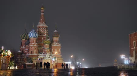 cobbles : Red Square on a winter night. St. Basils Cathedral. Kremlin wall, clock tower Stock Footage