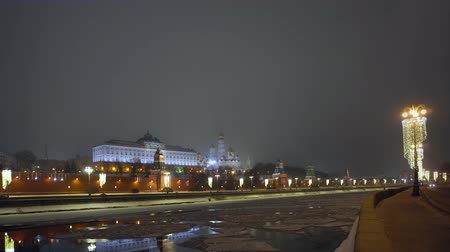 moscow panorama : Kremlin wall. Tower with red star on top. Moscow river covered with ice. Winter Stock Footage
