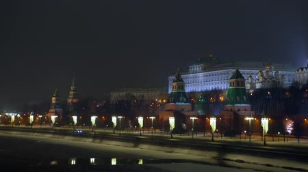 winter palace : Moscow river is covered with ice. Embankment. Kremlin wall. Winter Night. 4K Stock Footage