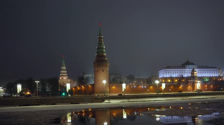 winter palace : Kremlin wall. Tower with red star on top. Moscow river covered with ice. Winter Stock Footage