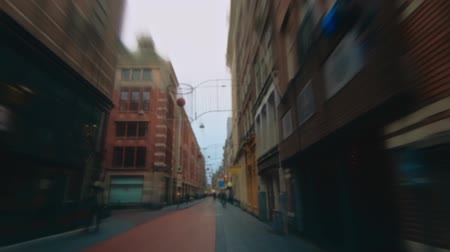 public worker : Defocused view. Gateway of Amsterdam. Walking pedestrians, Passing cars Stock Footage