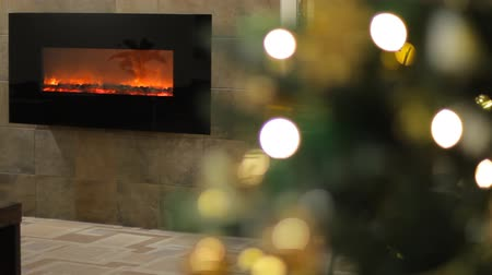 interiér : Christmas tree with Colorful  lights and fireplace