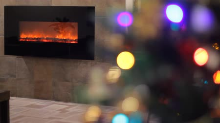 boŻe narodzenie : Christmas tree with Colorful  lights and fireplace