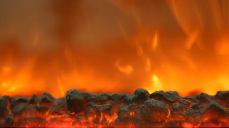günlüğü : Electric fireplace with a burning coals and red-orange background Stok Video