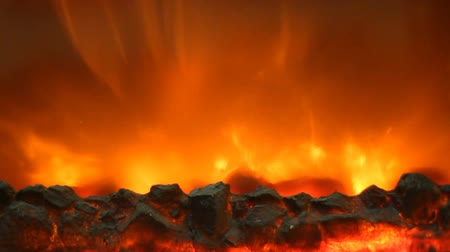 alevler : Electric fireplace with a burning coals and red-orange background Stok Video