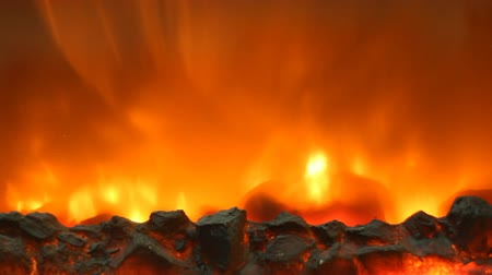 lighting equipment : Electric fireplace with a burning coals and red-orange background Stock Footage