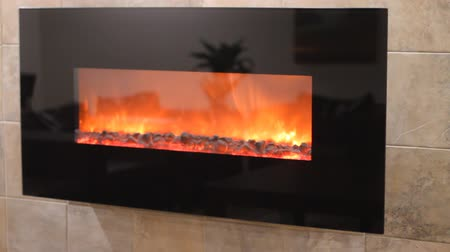 interiér : Electric fireplace with a burning coals and red-orange background Dostupné videozáznamy