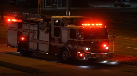 ambulância : Firetruck is on the side of the road at night in the city  Stock Footage