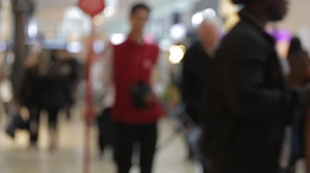 Abstract blur background. Crowd of walking people in the shopping mall center with bokeh