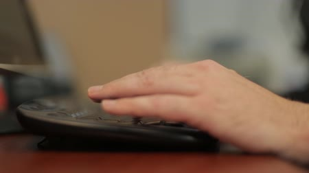 Mens hands typing on a keyboard Стоковые видеозаписи