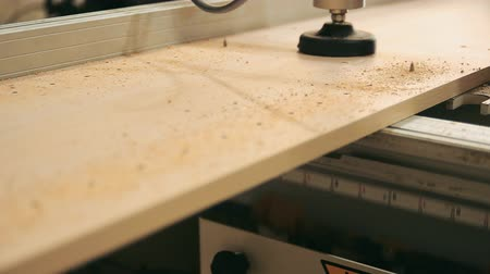 plywood : Furniture Drilling Machine, processes furniture stock from chipboard Stock Footage