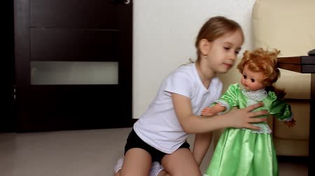 boneca : Cute little girl plays with dolls house Vídeos