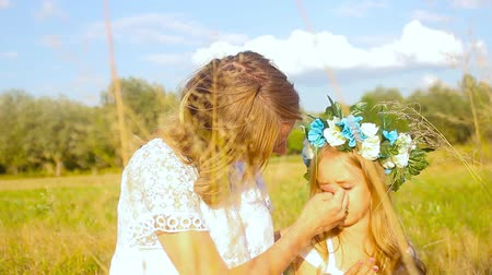 lánya : Happy mother with cute little daughter lying down on fresh green grass field, joyful family with pleasure spending time together outdoors, enjoying summer holidays Stock mozgókép