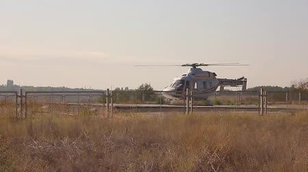 heliport : Air rescue service. Helicopter air ambulance is ready for take off at the heliport. Cooperation between air rescue service and emergency medical service on the ground. Helicopter take off. Stock Footage