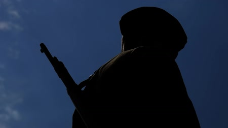 guns : Silhouette of young soldier