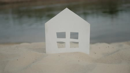 sand paper : The symbol of the house standing on the rivershore.