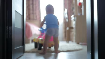 learning to walk : Baby with learning walker in the home. Stock Footage
