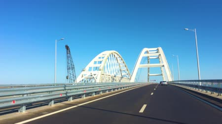połączenie : POV view road of The Crimean Bridge, Kerch Bridge, colloquially the Kerch Strait Bridge with road and rail passages across the Kerch Strait.